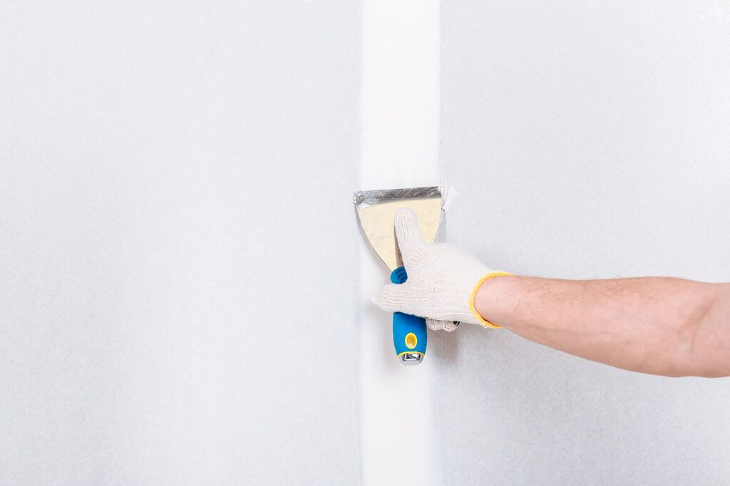 how to fix cracks in drywall